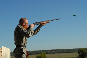 skeet_shoot_man_clear_sky